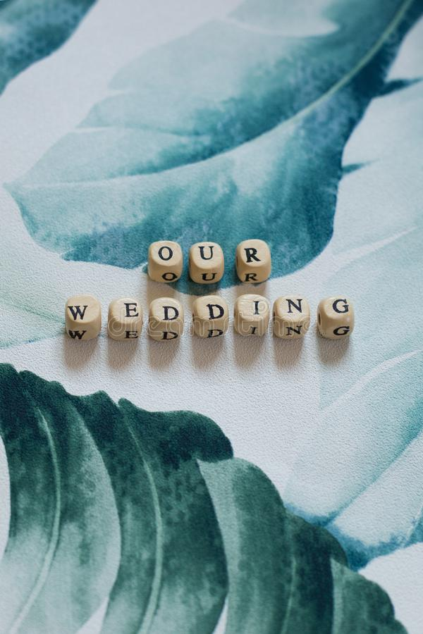 Our Wedding on a tropical leaf background stock images