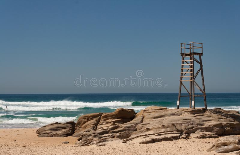 Wooden lifesaving tower with blue sky background on a summer day stock photos