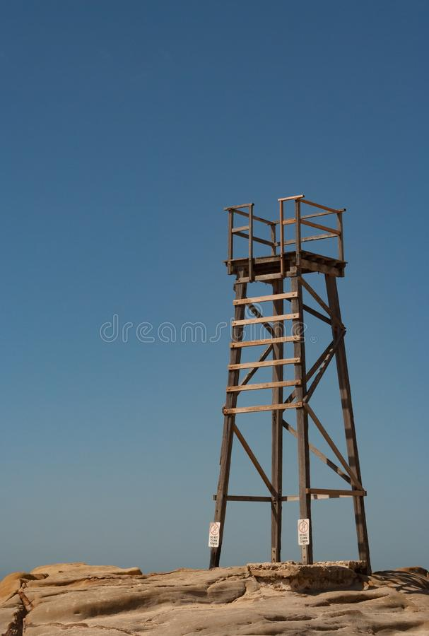 Wooden lifesaving tower with blue sky background on royalty free stock photography