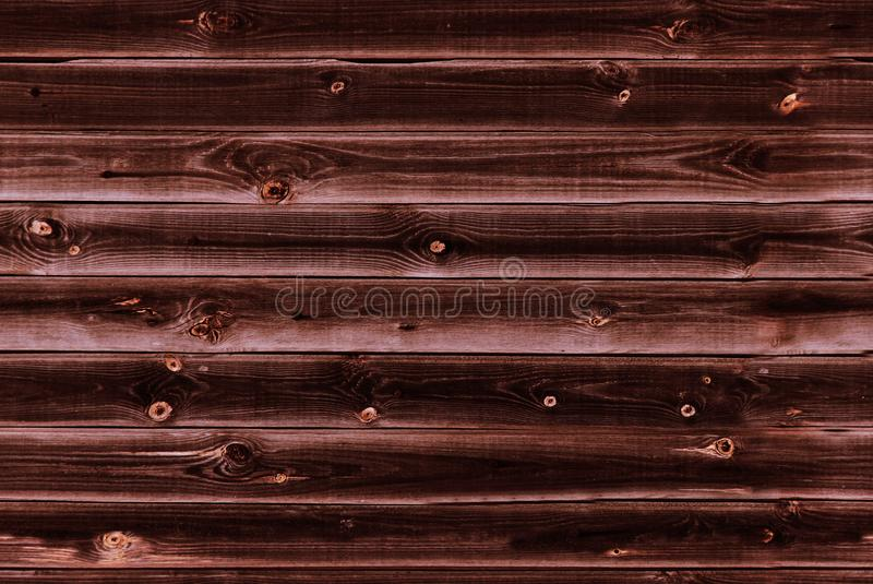 Wooden lining boards wall. dark mahogany brown wood texture. background old panels, Seamless pattern. Horizontal planks royalty free stock images