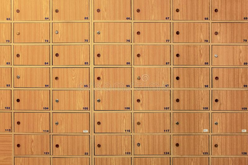 Wooden locker boxes, with metal locks in the post office. stock photography