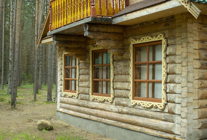Wooden log house. Window with shutters of a wooden house.  stock photo