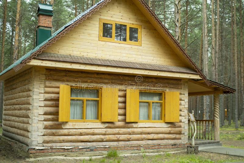 Wooden log house. Window with shutters of a wooden house.  stock photos