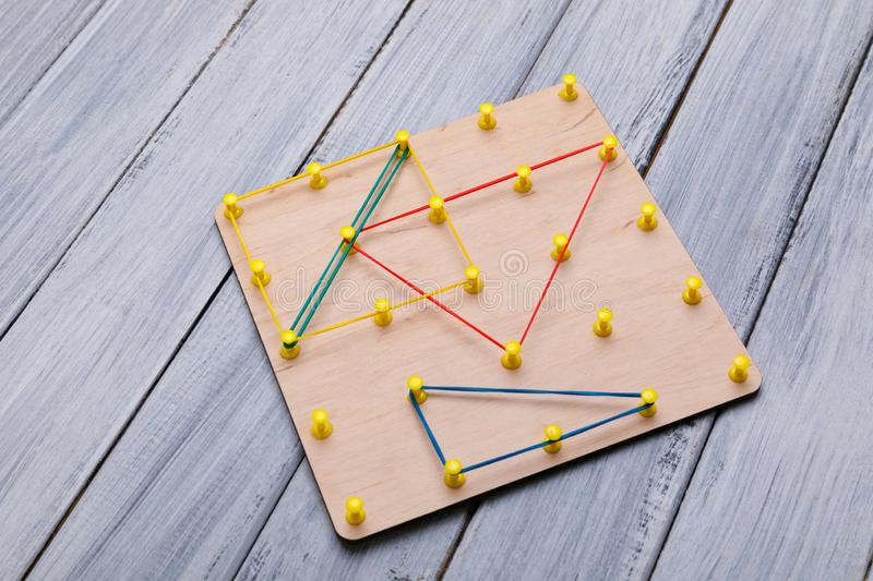Wooden logic toy. Creativity toys. The concept of logical thinking. stock photos