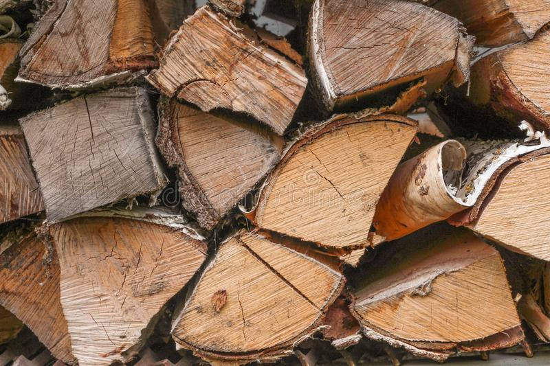 Wooden logs, firewood. Fuel. Harvesting firewood for the winter.  stock photography