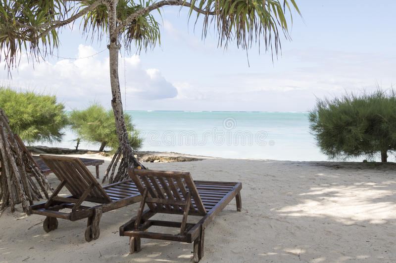 Wooden lounge chairs stock photo