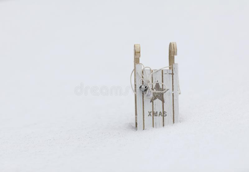 Wooden made sleigh in the snow. Closeup royalty free stock photos