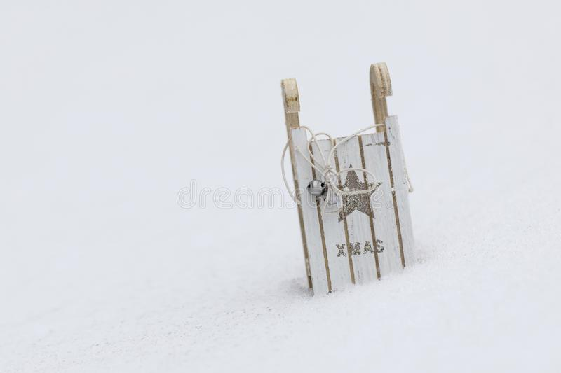 Wooden made sleigh in the snow. Closeup stock images