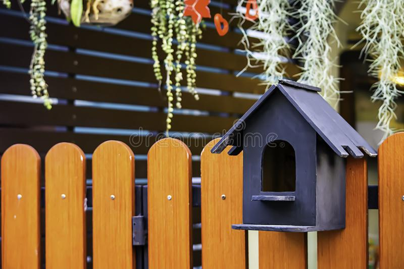 The wooden mail box is a small house.  stock photography