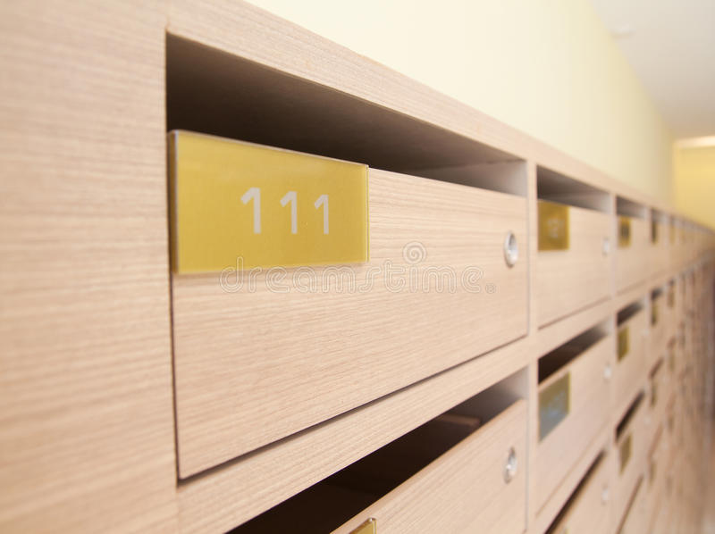 https://thumbs.dreamstime.com/b/wooden-mailbox-apartment-panel-condominium-residential-place-31092902.jpg