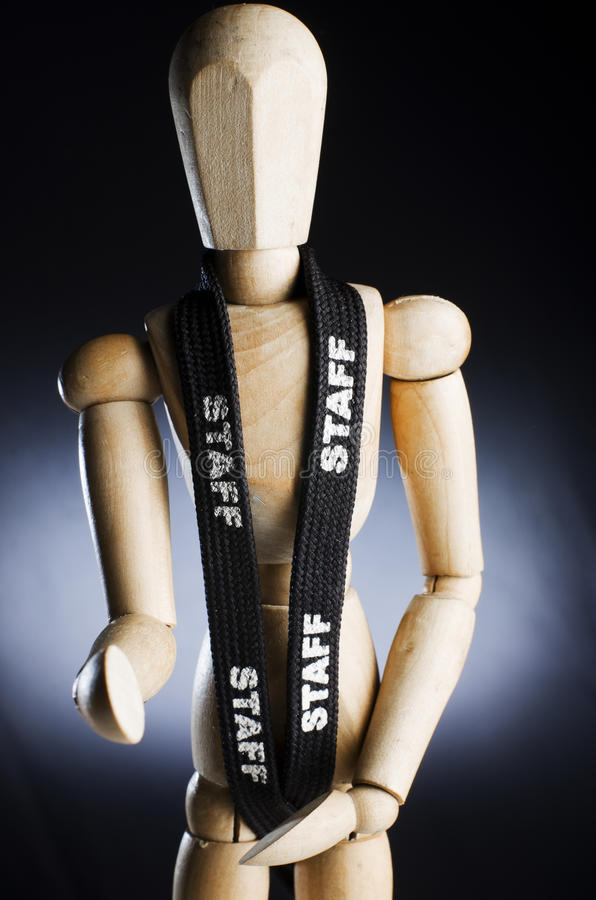 Wooden man as a staff. On black stock image
