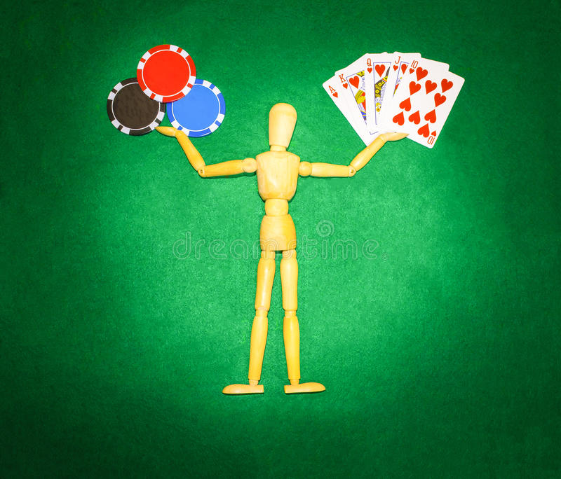 Wooden man with hands up to hold chips and cards for playing poker. The wooden man with hands up to hold chips and cards for playing poker stock images