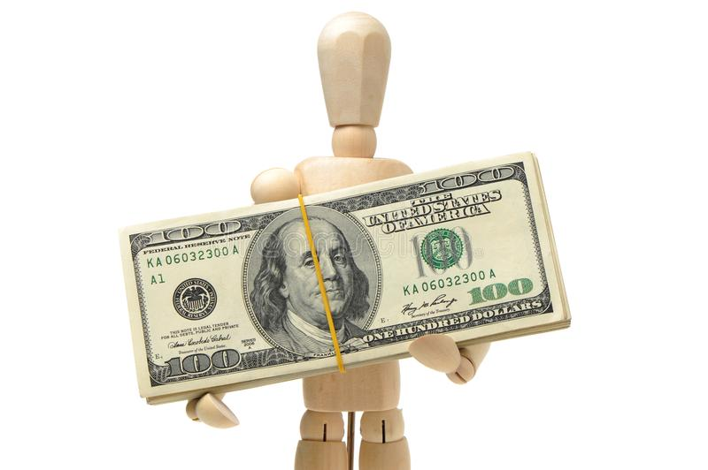 Wooden man has money. On white background royalty free stock photos
