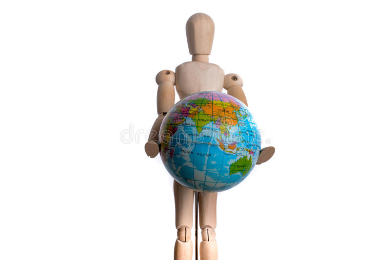 Wooden man holding a globe. On a white background stock photography