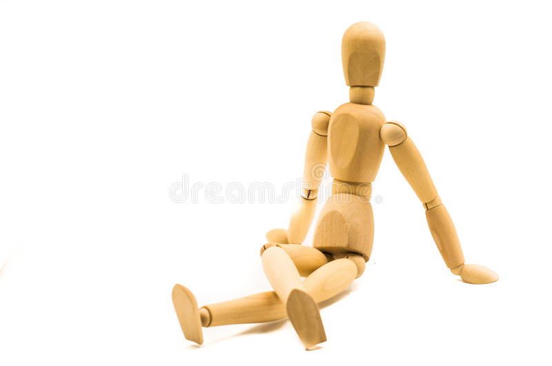 Wooden man puppet. Sitting on white background stock photos