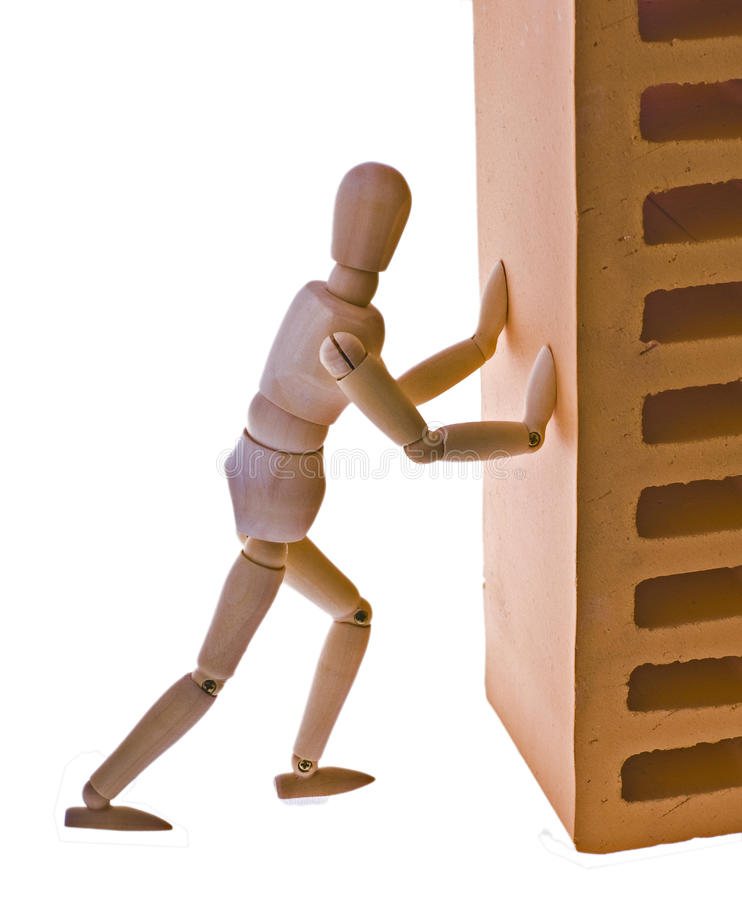 Wooden man pushes bricks. On white background royalty free stock photos