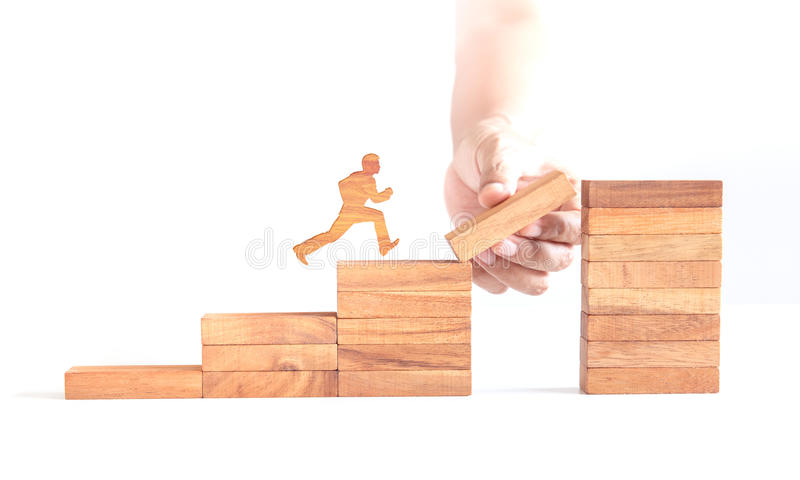 Wooden man run across business cliff royalty free stock image