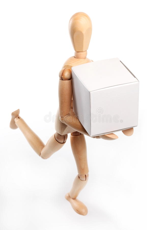 Wooden man running. With a white box stock photos