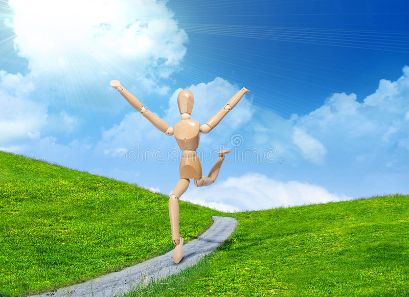Wooden man running. Through grassy hills stock images