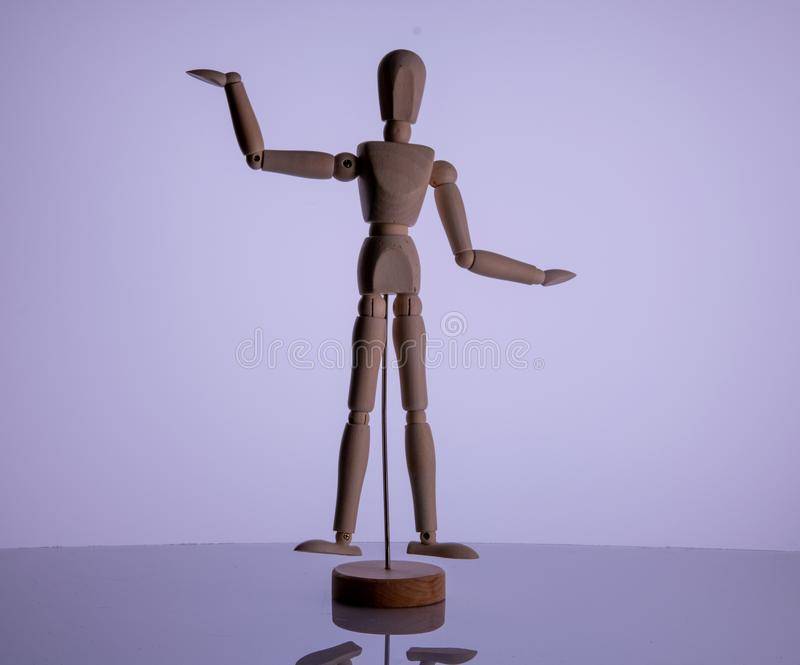 Wooden man toy on white background royalty free stock images