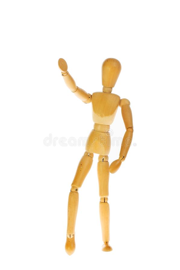 Wooden manikin against white stock images