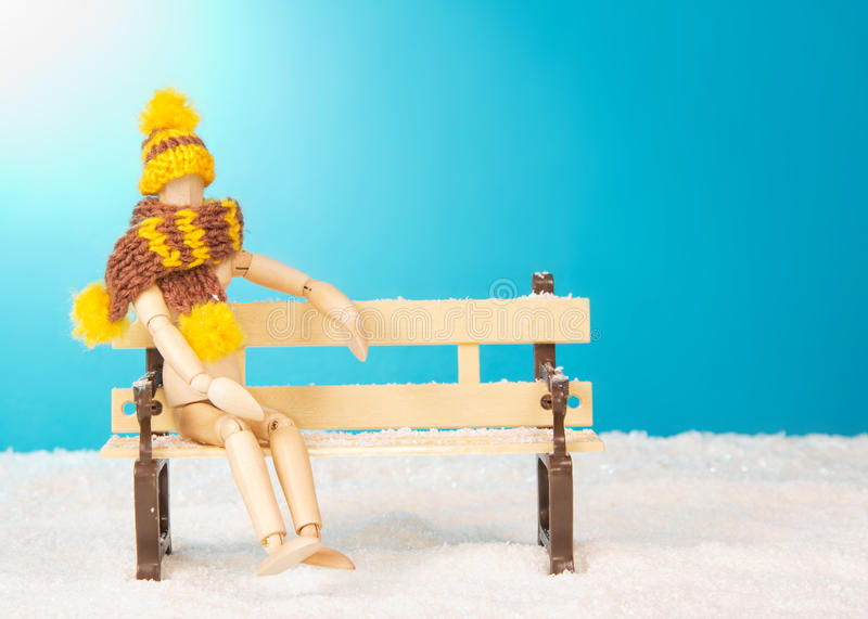 Wooden mannequin on bench stock photo