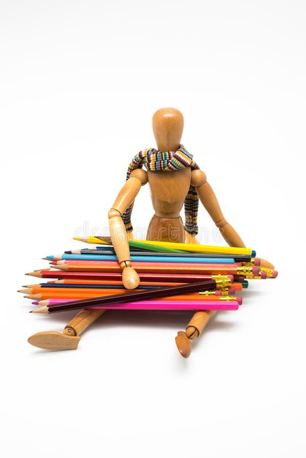 Wooden mannequin with colorful paints, back to school stock image