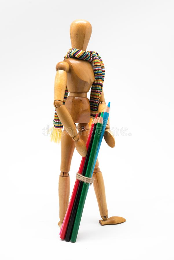 Wooden mannequin with colorful paints, back to school stock photo