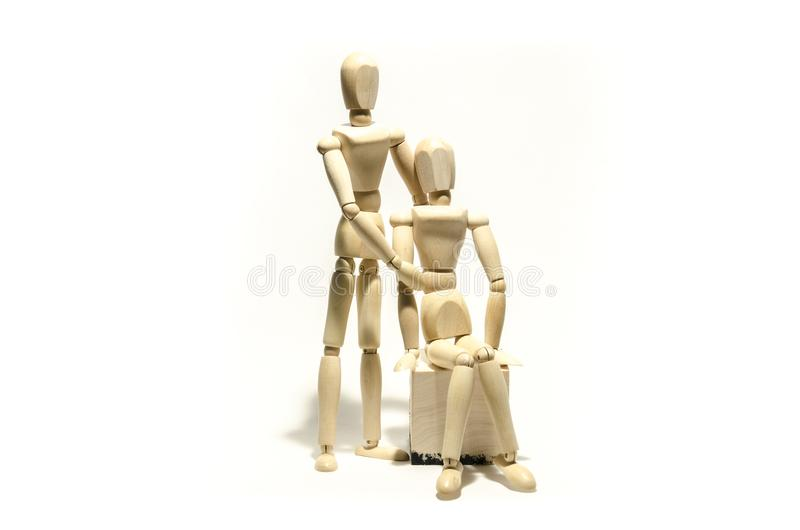 Wooden mannequin couple and wooden cube stock photography