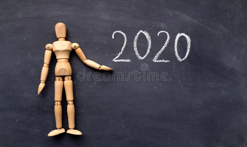 Wooden mannequin with handwriting text on chalk board royalty free stock photography