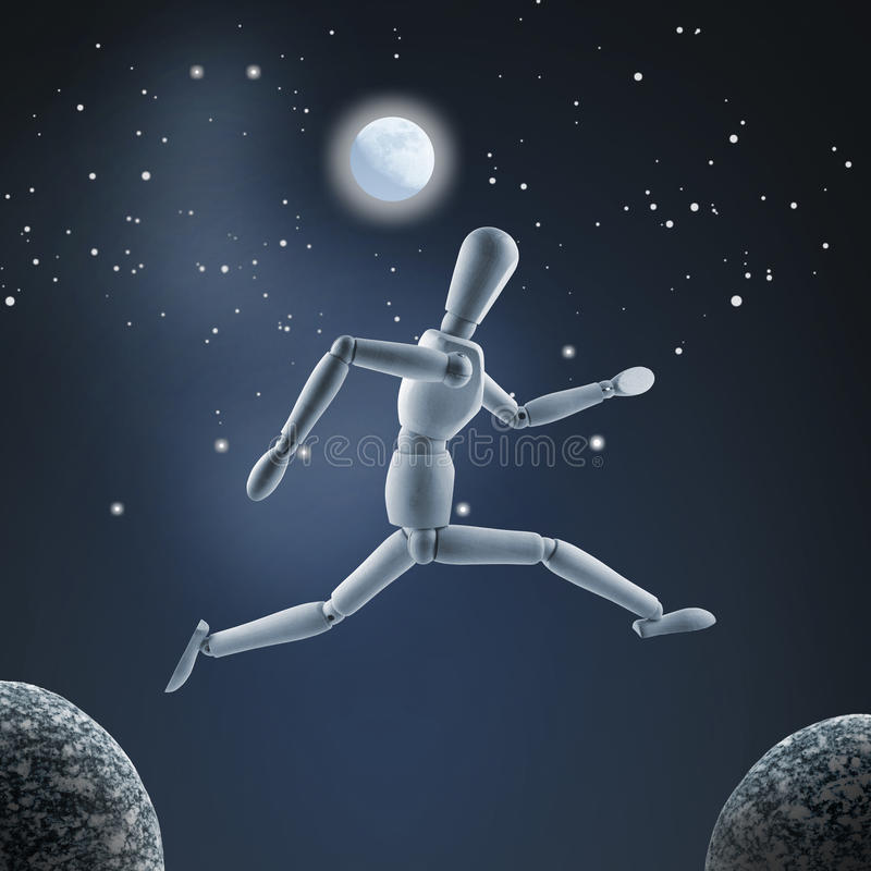 Wooden mannequin is jumping over the abyss at full moon as sky b stock images
