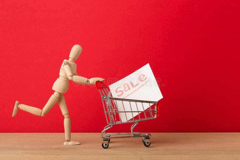 Wooden mannequin running for sales stock photo