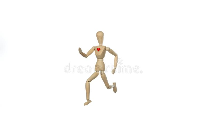 Mannequin running with red heart stock image