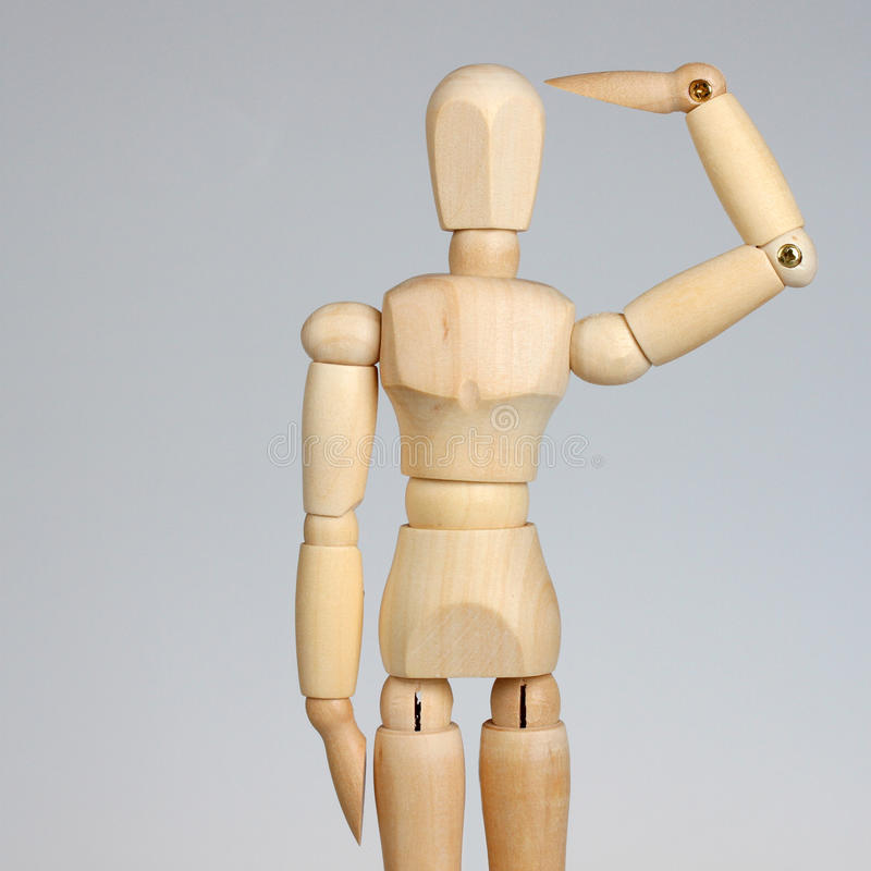 Wooden mannequin saluting royalty free stock photos