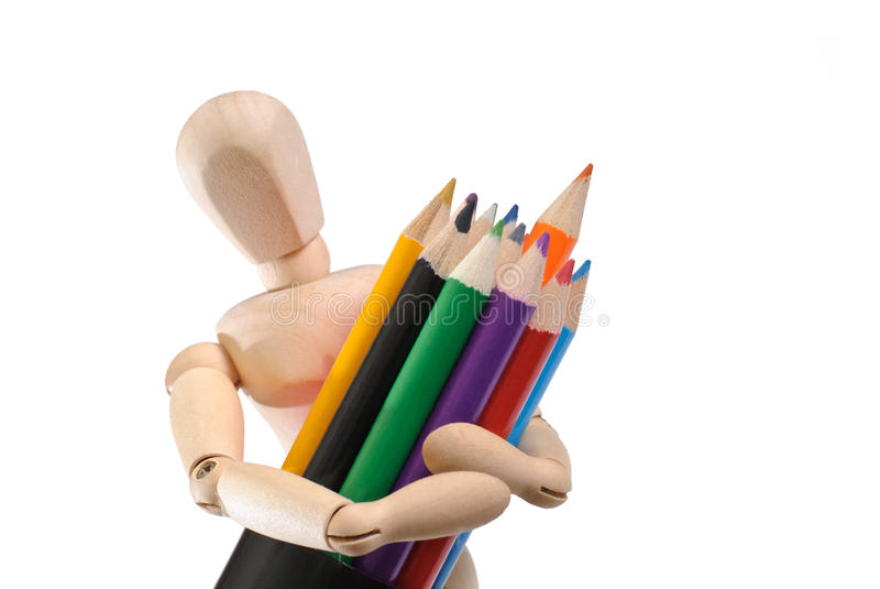 Wooden mannequin and set of color pencils royalty free stock image