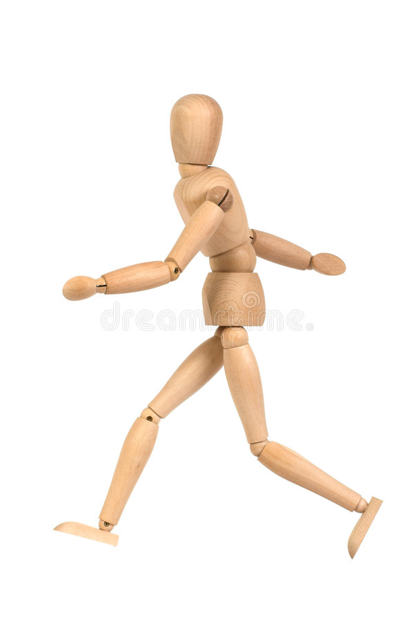 A wooden mannequin walking stock photos