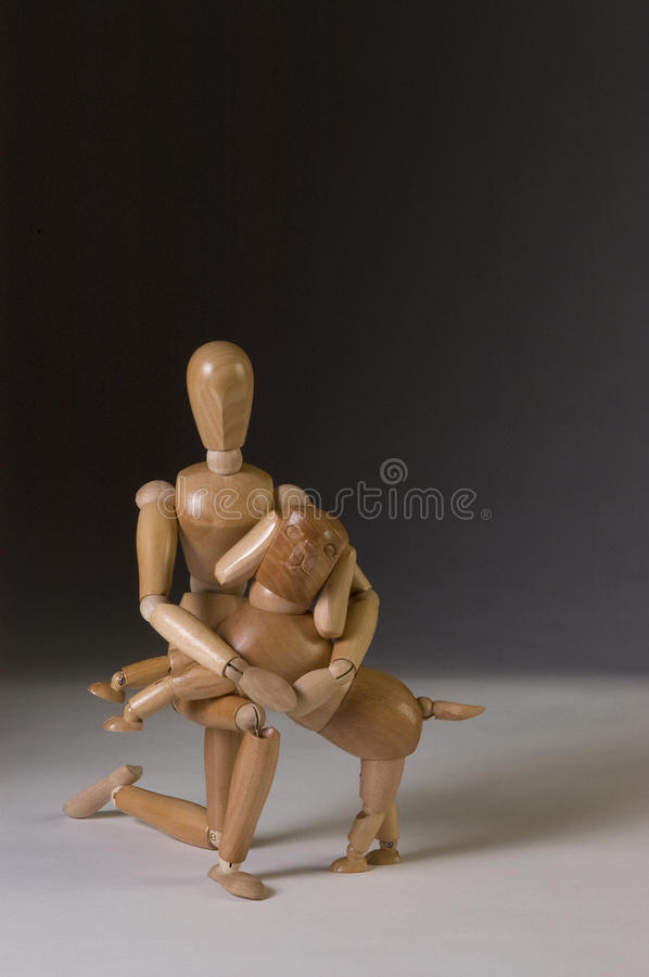 Wooden Mannequin with Wooden Dog royalty free stock image