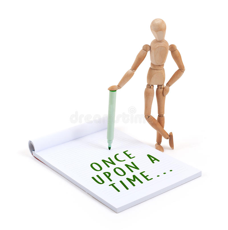 Free Wooden Mannequin Writing In Scrapbook - Once Upon A Time Stock Photo - 55283790