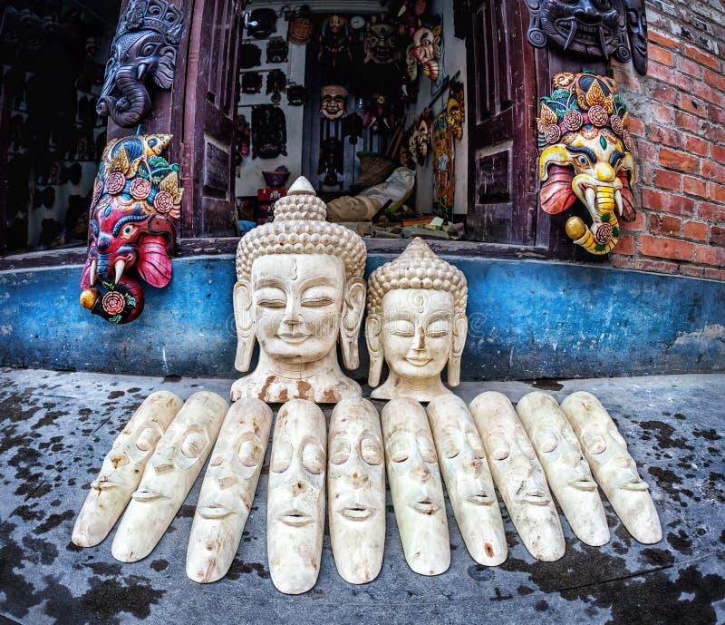 Wooden masks at Nepal market stock photography