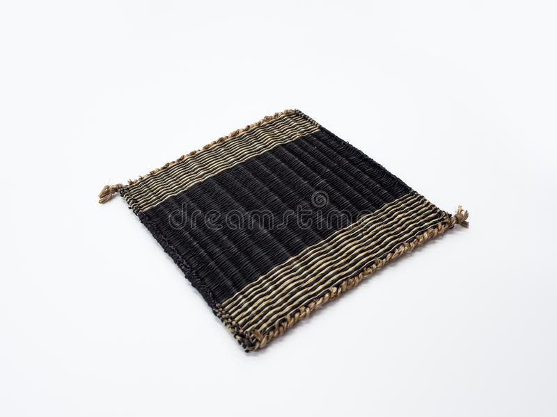 Wooden mat made from papyrus on white background.  stock photography