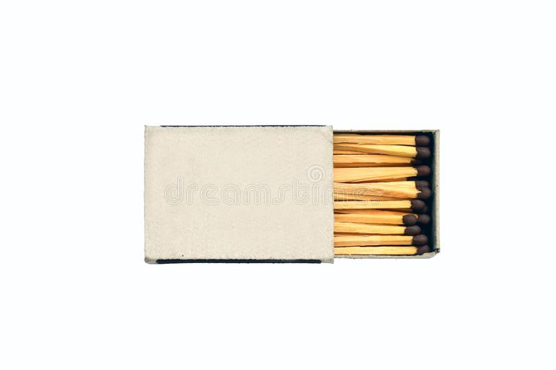 Wooden matches and matchbox isolated on white. Background royalty free stock photo