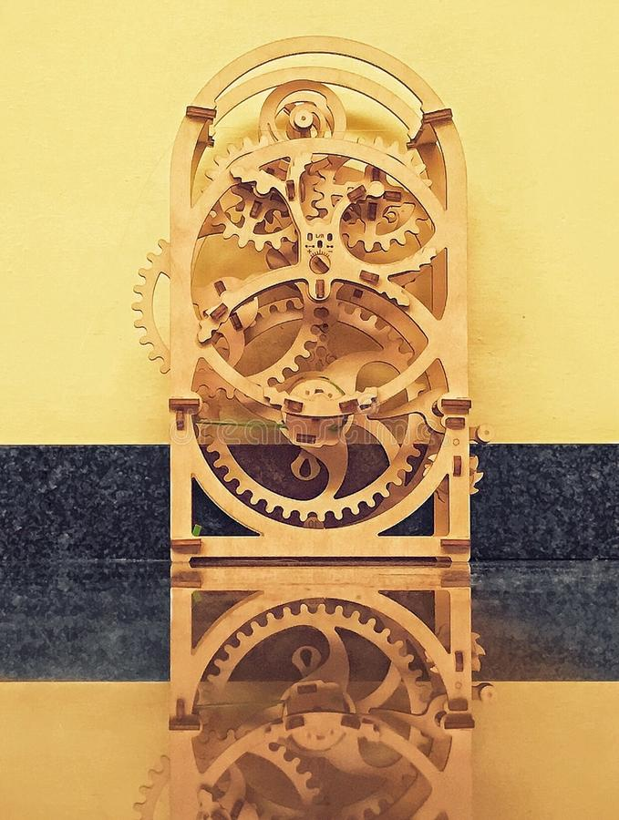 Wooden mechanism analog time measurement. Ancient wood clock with analogic gears mechanism royalty free stock photos