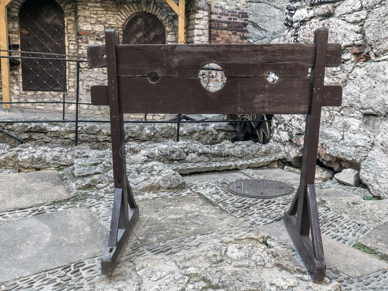 Wooden medieval pillory stock image