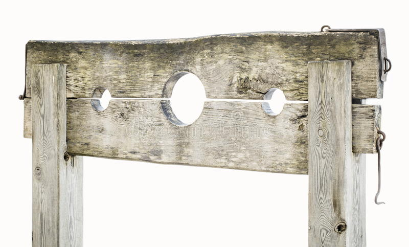 Wooden medieval pillory on white royalty free stock photos
