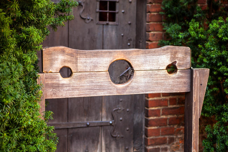 Wooden medieval torture device, ancient pillory royalty free stock image