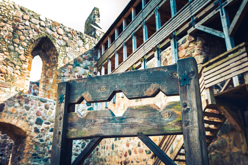 Wooden medieval torture device, ancient pillory in castle. stock photo