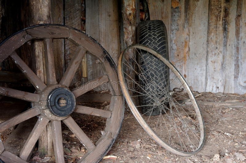 Wooden metal and rubber wheel improving concept. Three wheels: wooden, metal and rub stock photos