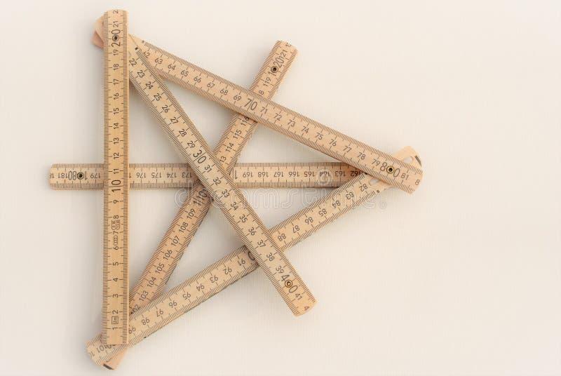 Wooden meter figure stock photography