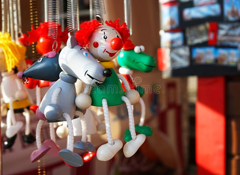 Wooden miniature toys clown and a variety of animals royalty free stock images