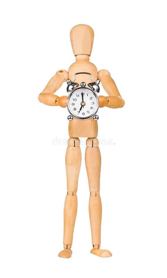Wooden model dummy holding alarm-clock royalty free stock photos